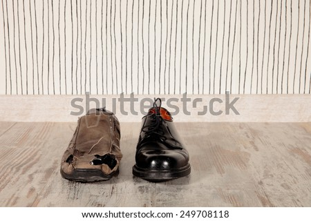 concept of rich and poor in a shoes - stock photo