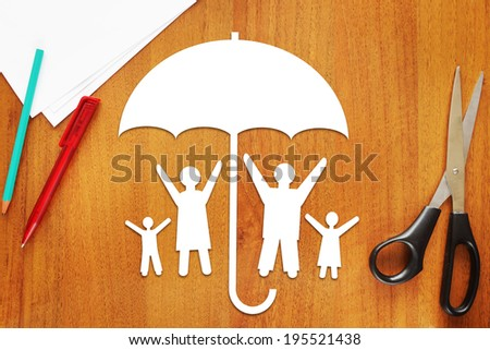 Concept of safe happy family - stock photo