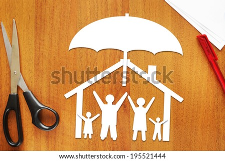Concept of safe united family - stock photo