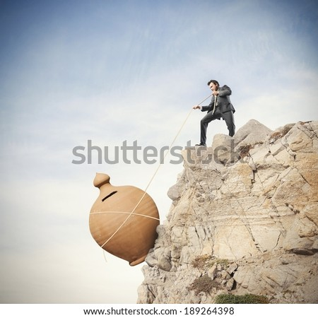 Concept of saving money from the crisis - stock photo