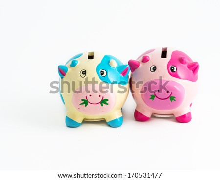 Concept of saving together. Couple of piggybanks together in saving money