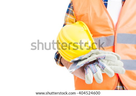 Concept of secure equipment with helmet, reflective vest and gloves in close-up isolated on white - stock photo