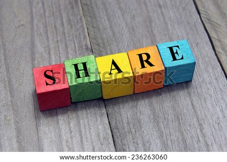 concept of share word on wooden cubes - stock photo