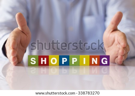 Concept of SHOPPING Word on Colorful Wooden Cubes - stock photo