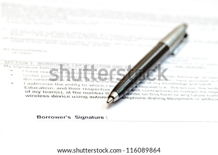 Concept of signing loan agreement with pen - stock photo