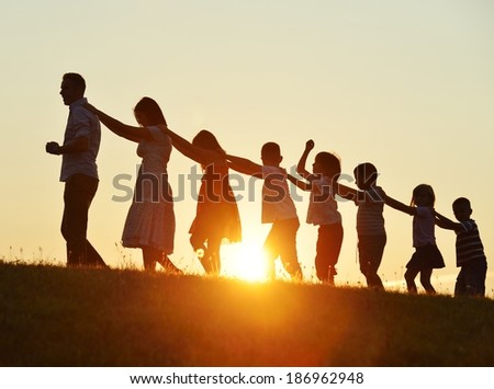 Concept of silhouettes on summer sunset - stock photo