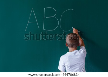 Concept of simple letton of child at school with copy space - stock photo