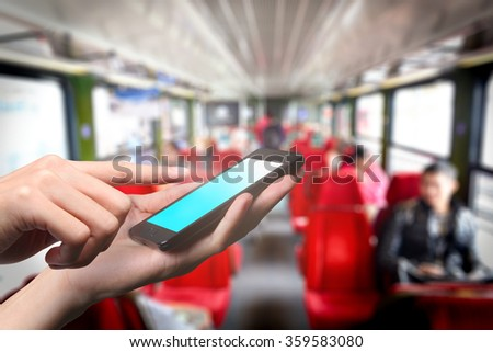 Concept of smart phone using in the train cabin. Closed up hand of man touch screen. - stock photo