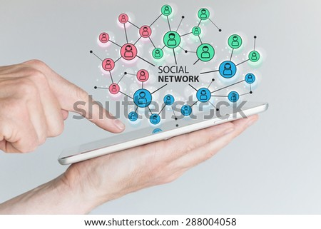 Concept of social network to connect friends, families and global workforce. Hand holding tablet or smart phone to communicate with people as digital assistant. - stock photo