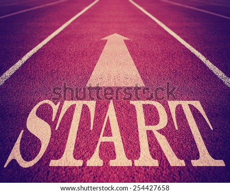 Concept of start with an arrow on a track for business toned with a retro vintage instagram filter effect app or action with a grunge look  - stock photo