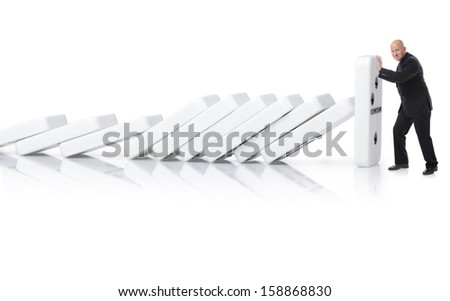 Concept of stopping a domino effect a buisnessman pushing up the last piece isolated on a white background - stock photo