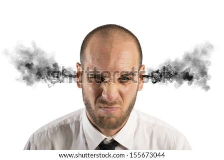 Concept of stress at work with businessman with smoke - stock photo