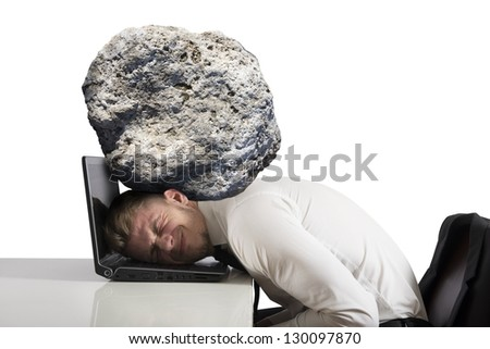 Concept of stress with businessman with a rock on the head - stock photo