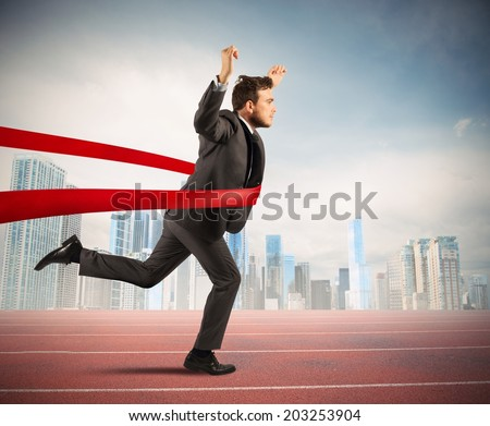 Concept of successful businessman in a finishing line - stock photo
