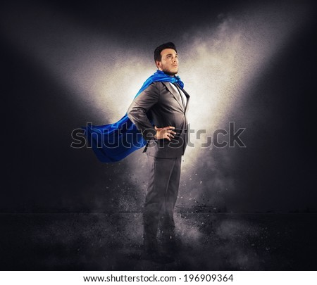 Concept of successful businessman like a super hero - stock photo