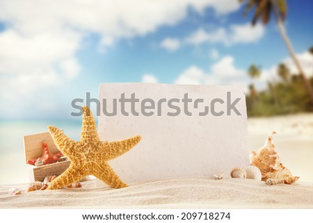 Concept of summer beach with starfish, shells and empty paper fr message. - stock photo