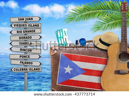 Concept of summer traveling with old suitcase and Puerto Rico