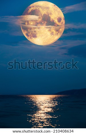 Concept of supersized Full Moon - Elements of this image furnished by NASA - stock photo