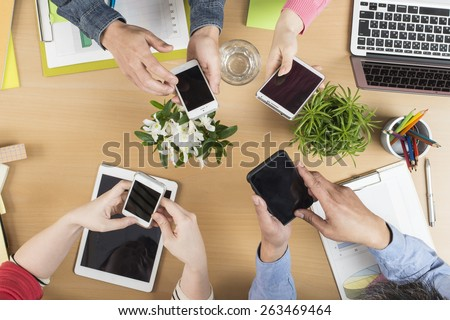 Concept of team of business using tablet and smart phone with mobile phone - stock photo