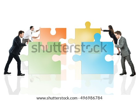 Concept of teamwork and partnership with businesspeople and puzzle.