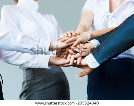 concept of teamwork. business people joined hands