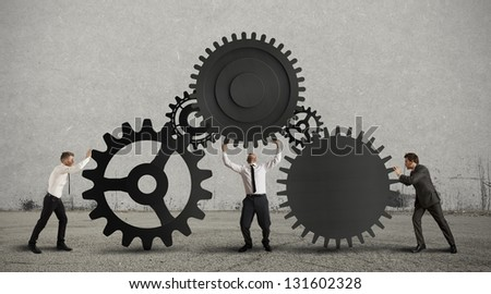 Concept of teamwork with gear system - stock photo