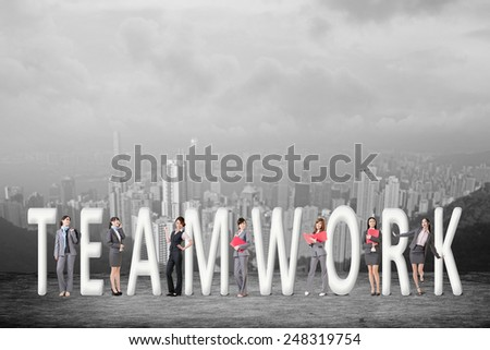 Concept of teamwork with group of business people stand with 3d text.  - stock photo