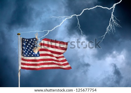 Concept of the economic crisis with the American flag struck by lightning - stock photo