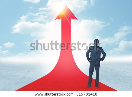 Concept of the road to success with a businessman standing on a red arrow - stock photo