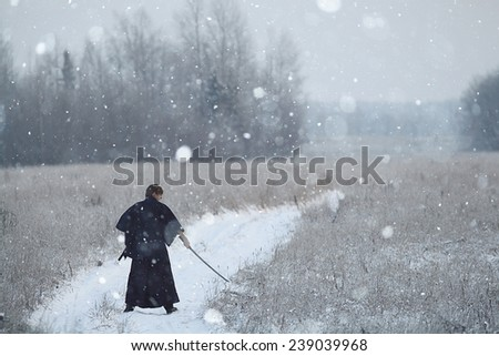concept of the way Eastern philosophy, the monk samurai in winter field - stock photo