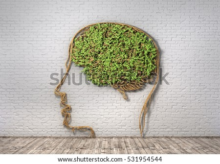 Concept of thinking. The green plant in form of human head with brain on a brick wall background and wood floor. Thought breaks out. 3d illustration