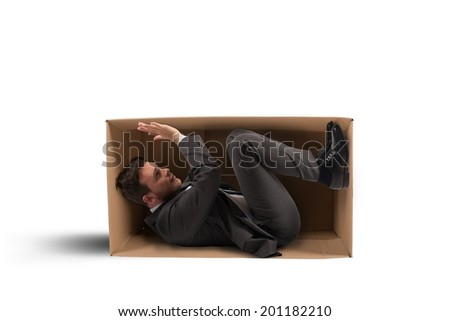 Concept of tight work with a businessman inside a carton - stock photo
