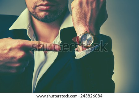 concept of time. watches on the arm of stylish businessman - stock photo