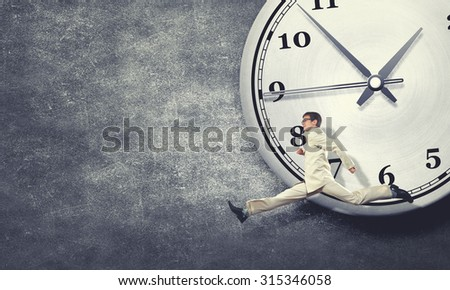 Concept of time with funny businessman running in a hurry - stock photo