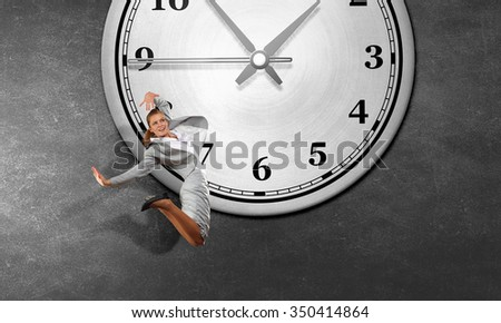 Concept of time with funny businesswoman running in a hurry