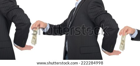 Concept of trade and taking a cut with money passing hands isolated on a white background