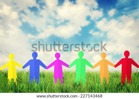 Concept of unity and friendship. Many multicolored paper people characters stand outdoor together