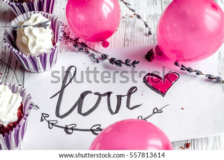concept of Valentine's Day cupcakes wooden background close up