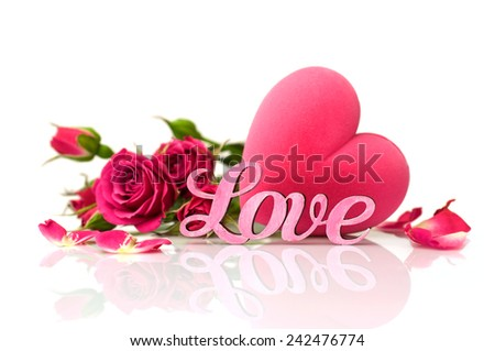 """Concept of Valentine's Day. Pink word """"love"""", gift box in the shape of hearts and roses - stock photo"""