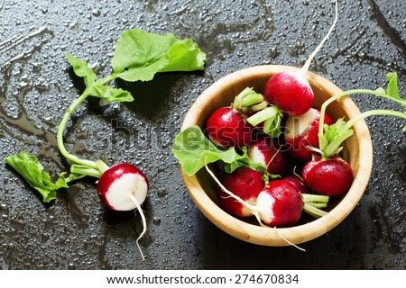 Concept of vegan food - radishes with water drops, selective focus