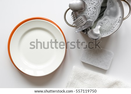 concept of washing dishes on white background top view