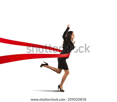 Concept of winner businesswoman in a finish line - stock photo