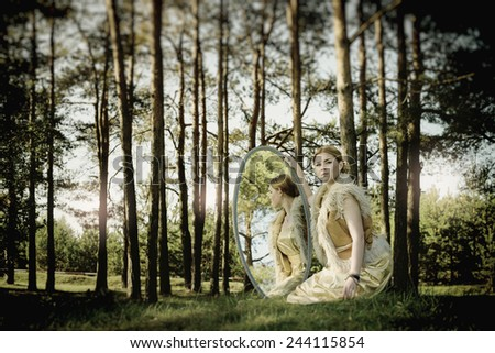 concept of wonderful fairy tale with beautiful girl in country of mirror - stock photo
