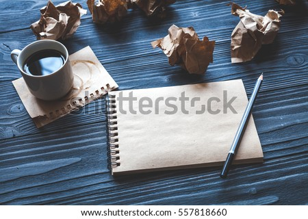 concept of writer desktop wooden background top view mock up