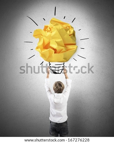 Concept of young boy with a big idea - stock photo