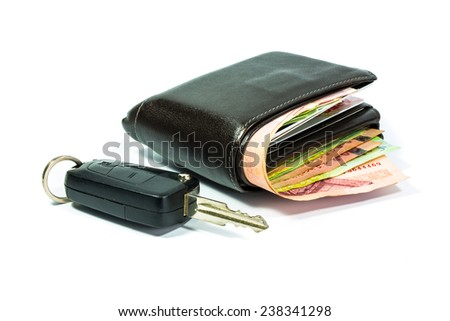 concept Old wallet with car remote key control - stock photo