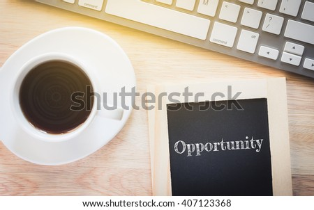 Concept Opportunity message on wood boards. A keyboard and a glass coffee table.Vintage tone. - stock photo