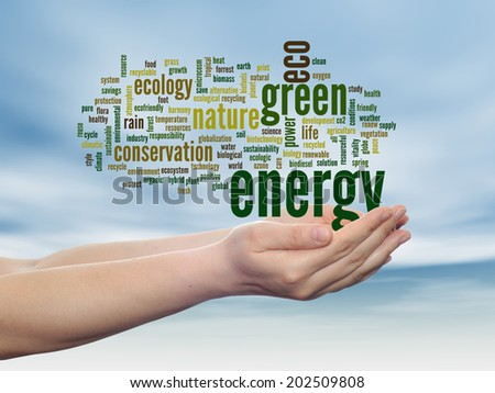 Concept or conceptual abstract green ecology, conservation word cloud text in man hand, blue sky background for environment, recycle, earth, clean, alternative, protection, energy, eco friendly or bio - stock photo