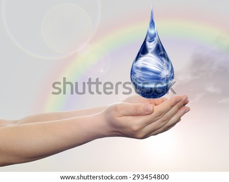 Concept or conceptual blue water or liquid drop falling in two woman hands on rainbow sky background - stock photo