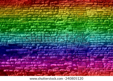 Concept or conceptual colorful painted or graffiti old vintage grungy brick wall texture or urban background - stock photo
